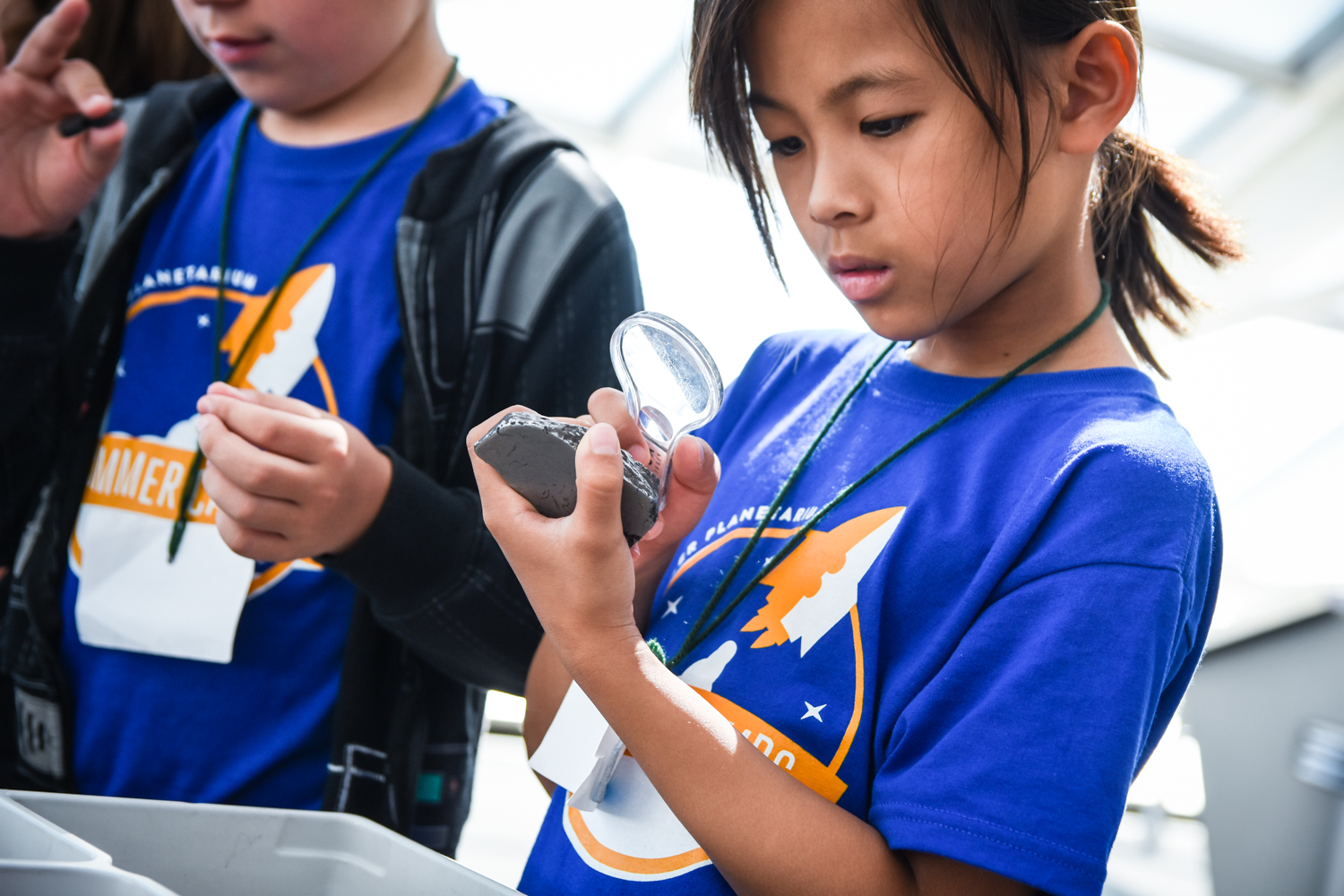 Adler Summer Camp Participant Looking At Space Rock