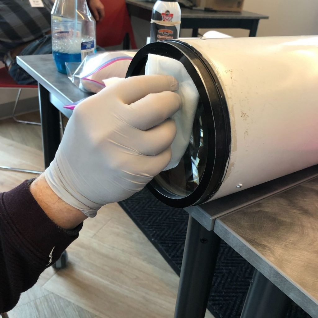 "While we're at it, why not do some additional cleaning? A Chicago Astronomical Society volunteer gives the 6"" finderscope lens some cleaning love."