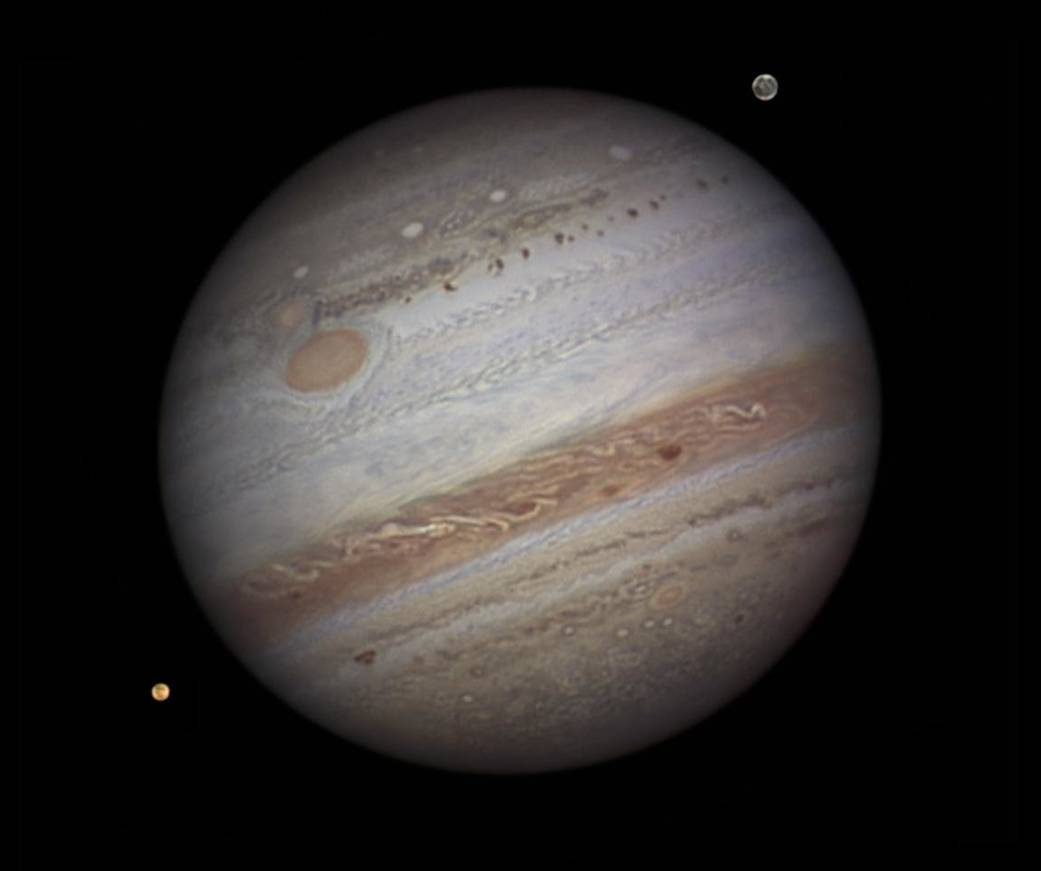 Jupiter and two of its Moons, Io and Ganymede