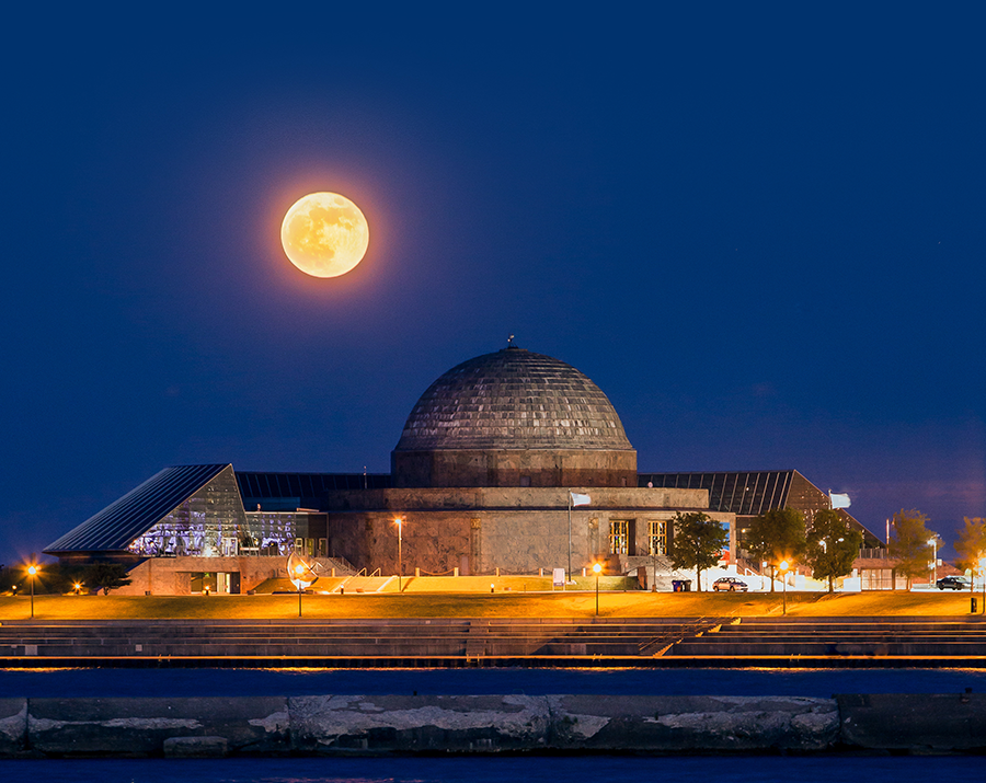 Moon rising over the Adler Planetarium