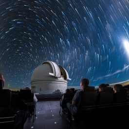 Guests viewing a sky show in the Adler's Grainger Sky Theater.