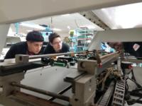 Adler Teens inspect machine in Far Horizons lab.