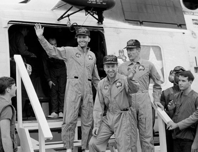 Apollo 13 crew returning home after their ocean landing.
