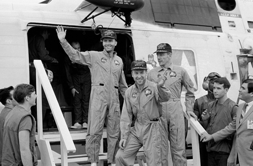 The crew of Apollo 13 land back on Earth.