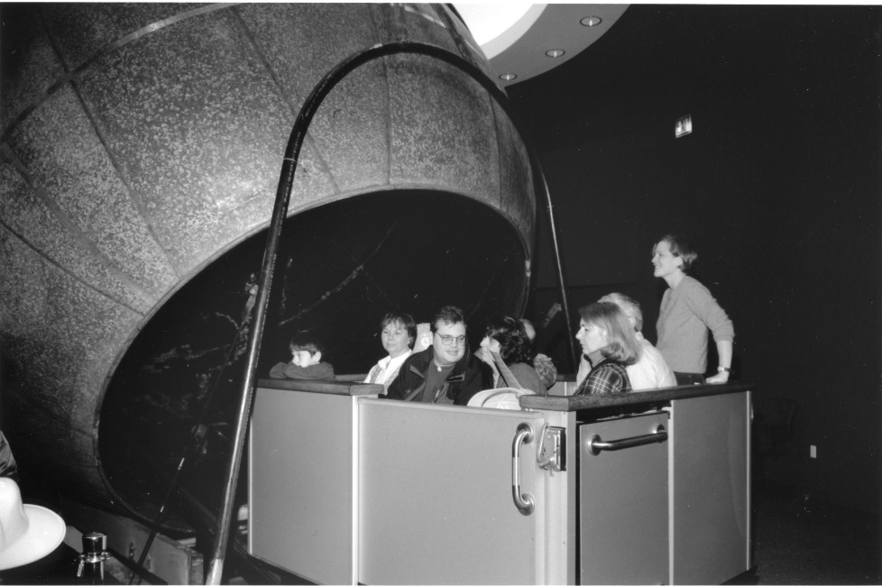 A full carload of visitors is pictured either going into or coming out of the Atwood Sphere.