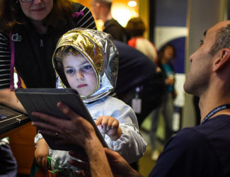 Child plays with tablet at Family Days at the Adler.