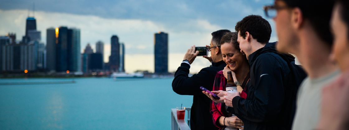 Guests laugh and admire the view of Chicago's skyline on the Adler's terrace.