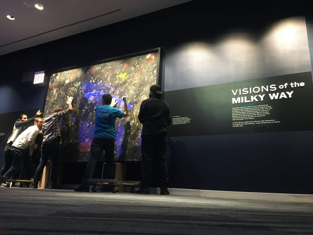 "Image: Adler staff installing Brown's ""Milky Way"" in the Adler Planetarium's new exhibit, Chicago's Night Sky."