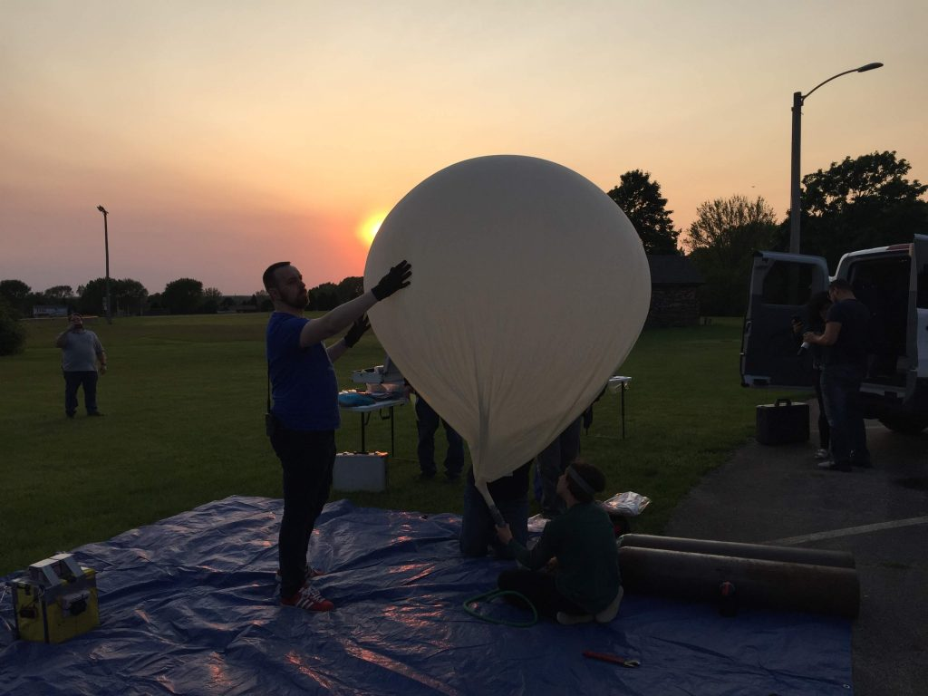 Far Horizons volunteers and staff prepare the balloon that carried the Chicago NITELite mission to the stratosphere on June 2, 2019.