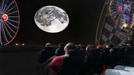 """Audience members viewing """"Imagine the Moon"""" in the Adler's dome theater."""