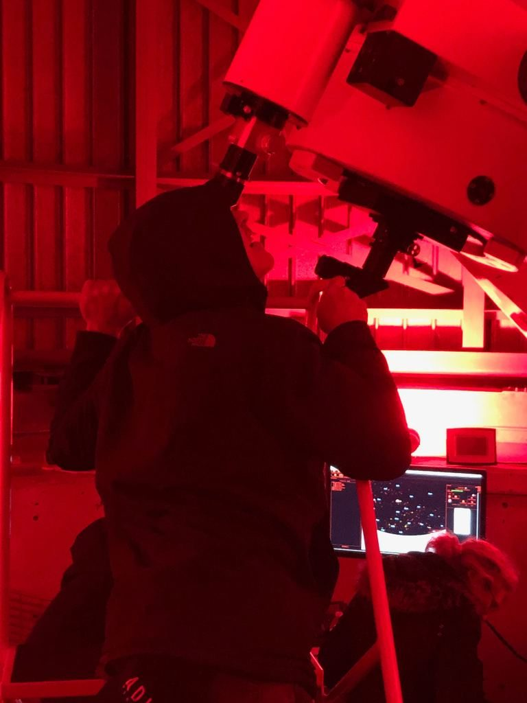 Chicago's own John Cusack enjoys a first look through the newly re-assembled telescope during Adler After Dark on March 21.