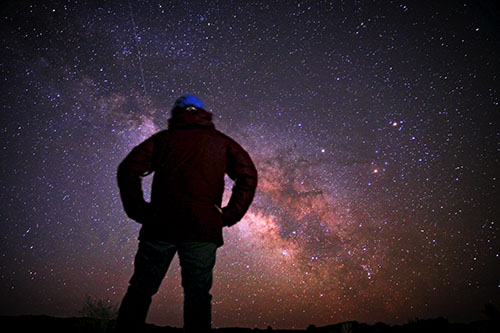 A skywatcher gazing up at the night sky.