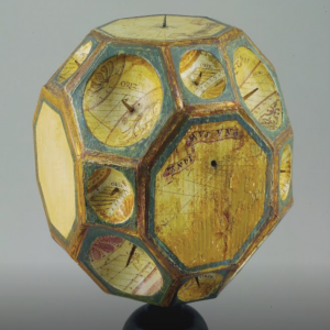 A 16th century, twenty-six-faced polyhedral sundial carved of wood.