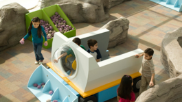 """A group of children playing in the Adler's """"Planet Explorers"""" exhibit."""