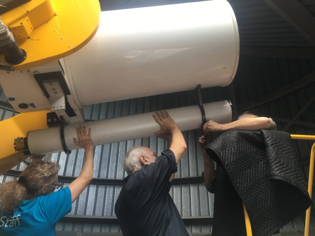 Michelle (left) and crew in the process of removing the mirrors from the telescope, September 2018.