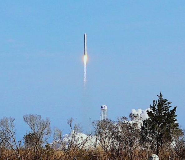 Rocket with the Adler Planetarium's first ThinSat launching into space.
