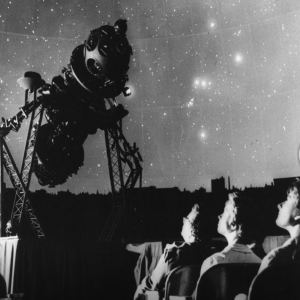 A black and white photo of seated visitors in the original Adler Sky Theater with the Zeiss Projector.