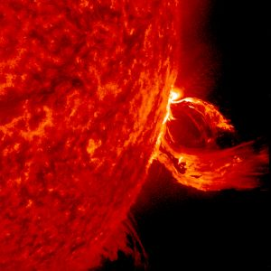A close up of a substantial coronal mass ejection, one type of solar storm, from June 2015. This image taken in an extreme ultraviolet wavelength shows a magnetic loop erupting on the solar surface.  Credits: Solar Dynamics Observatory/NASA