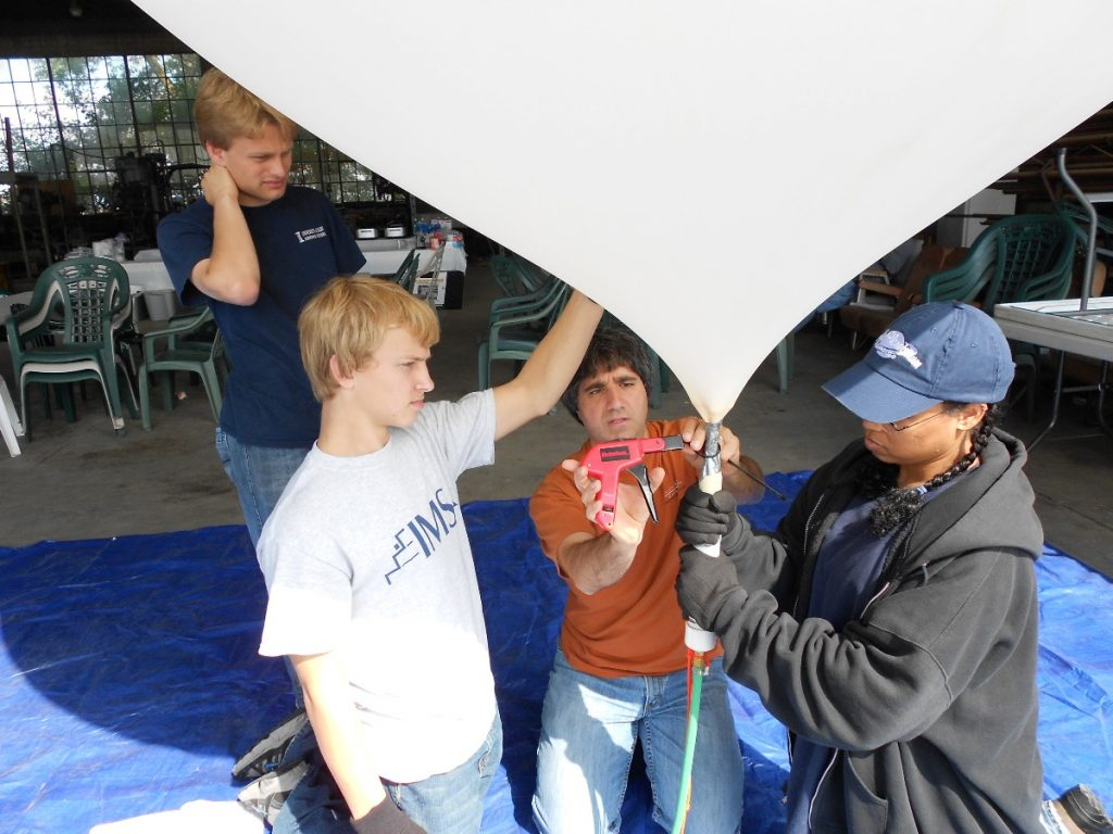 Spencer Gore (left background, blue shirt) participating in a Far Horizons balloon launch on September 4, 2011.