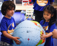 Adler summer campers playing with an inflatable globe.