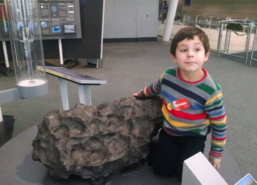 Hudson touching a real meteorite in 2014