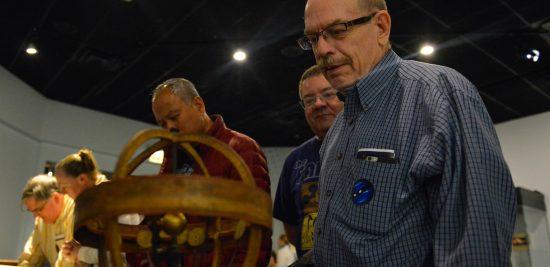 Visitors at the Adler Planetarium Viewing Our Telescopes Exhibit
