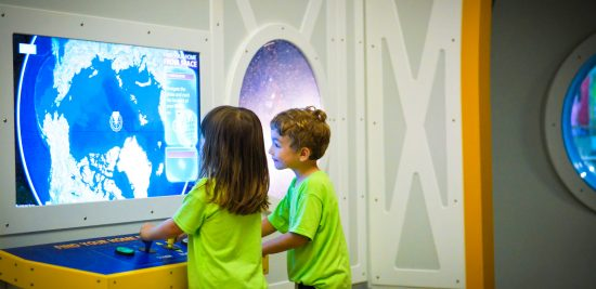 Young Visitors at The Adler Exploring our Planet Explorers Exhibit