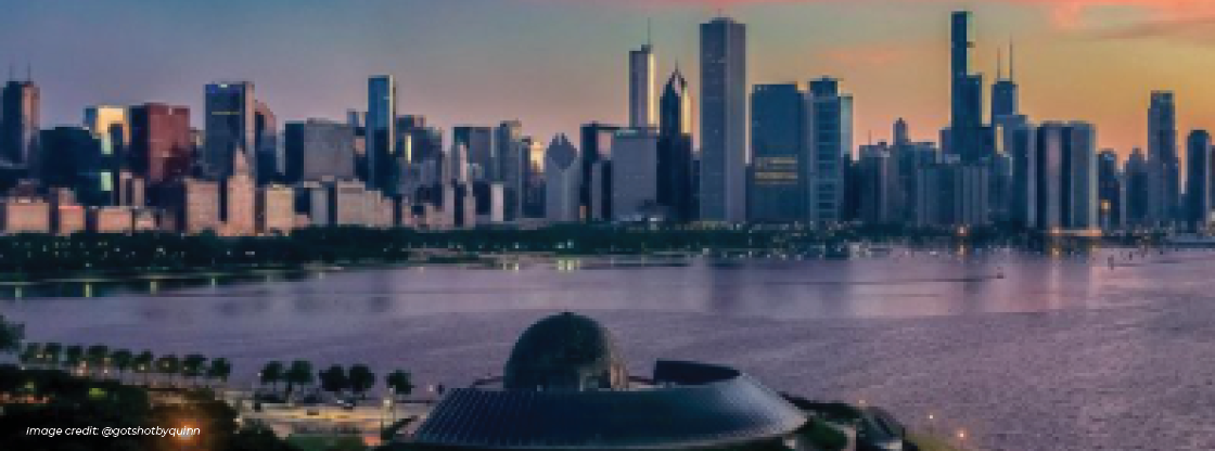 Aerial shot of the Adler with a skyline background at sunset
