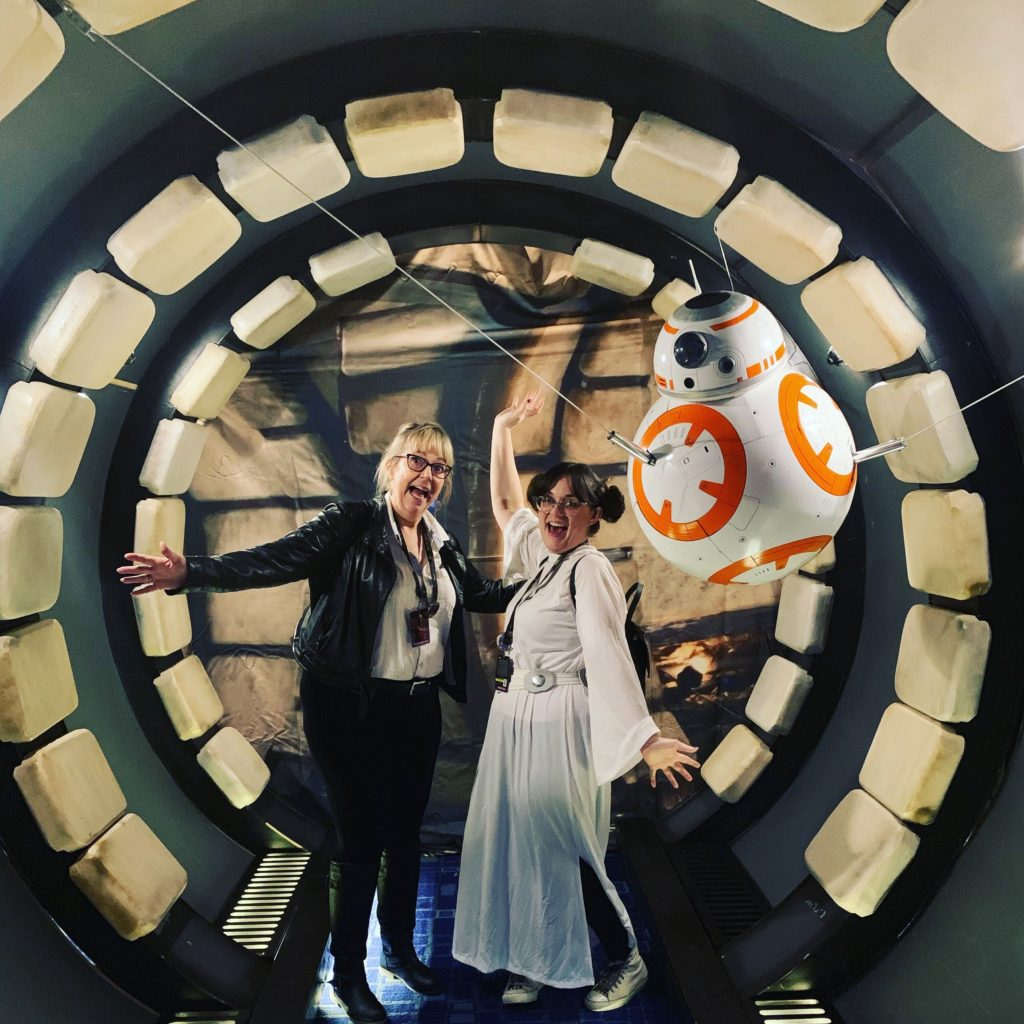 Adler employee Claire hanging out with BB-8 at the Star Wars Celebration in Chicago.