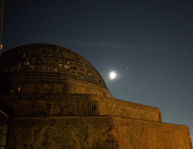 The Adler Planetarium with the Moon, Jupiter and Saturn in the background.