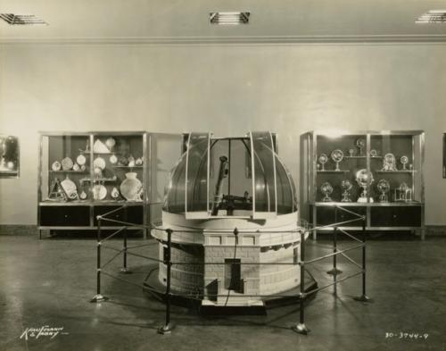 Model observatory and two display cases in an exhibit at the Adler Planetarium, c. 1933