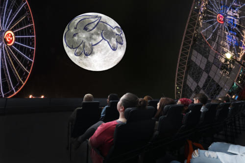 "Guests watching the Adler's newest sky show, ""Imagine the Moon."""