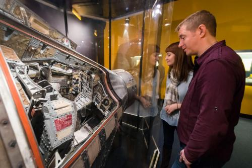 "Guests viewing the Gemini 12 spacecraft in the Adler's exhibit, ""Mission Moon."""