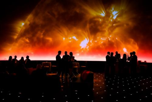 An image of Adler guests in the  Grainger Sky Theater during a private event.