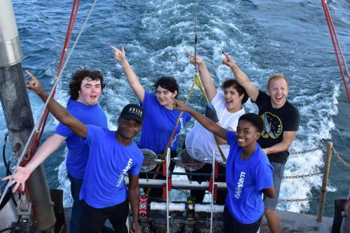 "An image of a group of smiling teens on board the Neeskay during a boat excursion for the Adler's ""Aquarius Project."""