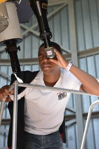 An image of an Adler guest, telescope observing in the Doane Observatory.