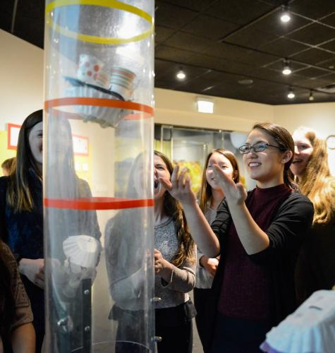 "An image of Adler guests eagerly participating in a science experiment in the Adler's ""Community Design Lab."""