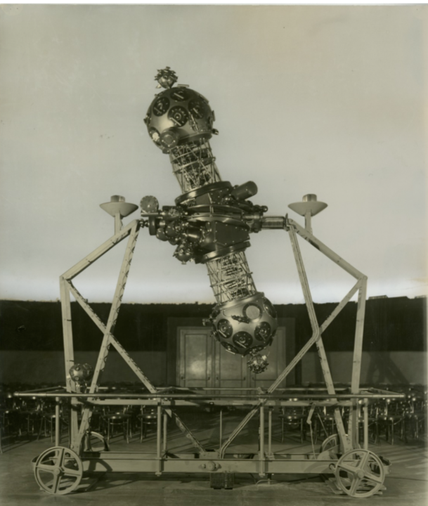 Image Caption: The Zeiss Mark II projector can be seen here in the Adler's original domed theater in the 1930s. Image Credit: The Adler Planetarium Archives