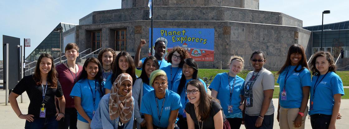Adler Teens pose in front of the Adler Planetarium.